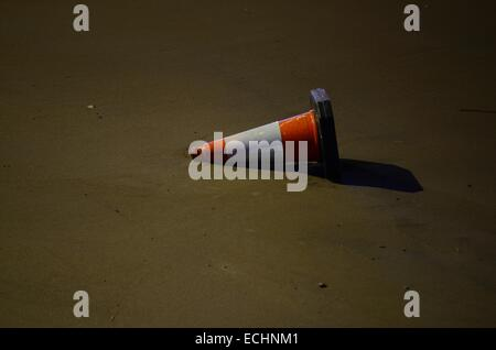 Traffic cone on the South Bank in London, England - Stock Photo