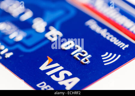 A Visa debit card with a logo for contactless payment. - Stock Photo