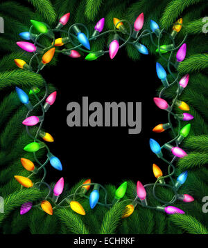 Holiday lights frame and new year christmas decoration on a black background with pine branches as a decorated border - Stock Photo