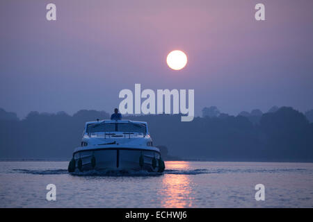 Cruise boat crossing Lough Ree at dawn, River Shannon, County Westmeath, Ireland. - Stock Photo