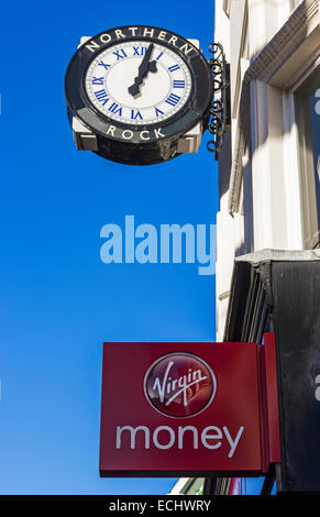Virgin Money sign with old Northern Rock clock in background - Stock Photo
