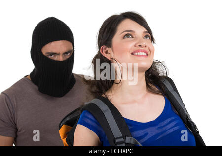 masked male thief robbing beautiful young girl - Stock Photo
