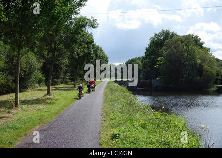 Cyclists on the Nantes- Brest Canal, Brittany France near Pontivy - Stock Photo
