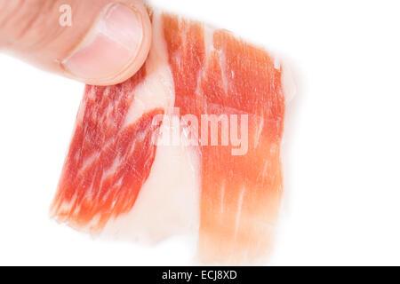 Top view of caucasian man hand taking Serrano ham slice on white - Stock Photo