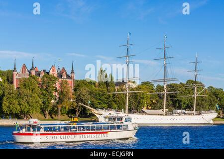 Sweden, Stockholm, view from Gamla Stan (Old Town) on Skeppsholmen island with the three-masted ship Af Chapman - Stock Photo