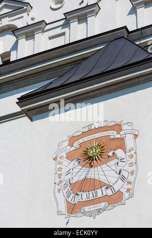 Lithuania (Baltic States), Vilnius, historical center listed as World Heritage by UNESCO, sundial on the facade - Stock Photo
