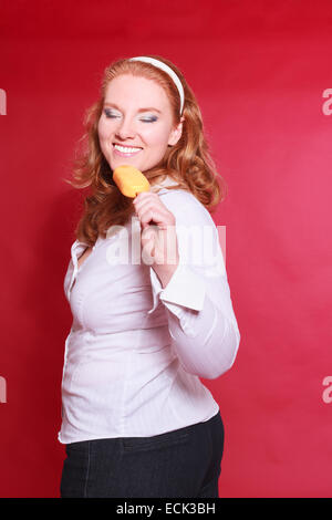 Red-haired woman with obesity, enjoy your popsicle - Stock Photo