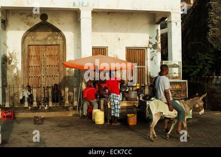 Kenya, Lamu archipelago, Lamu man on donkey shopping at the local sea front market - Stock Photo