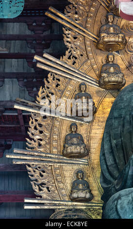 Nara, Japan. Detail of the mandorla surrounding the huge bronze Buddha in the Great Buddha Hall (Daibutsuden) at - Stock Photo
