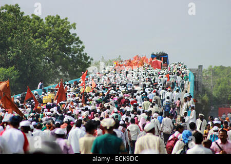 Procession of pilgrims or waris with musical instruments  at Pandarpur yatra - Stock Photo