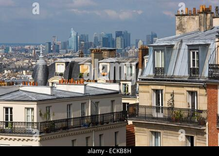 France, Paris, the city view from the heights of Montmartre, in the background the towers of La Defense - Stock Photo