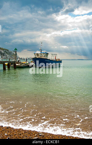 Vertical view of boats anchored in Alum Bay in the Isle of Wight. - Stock Photo
