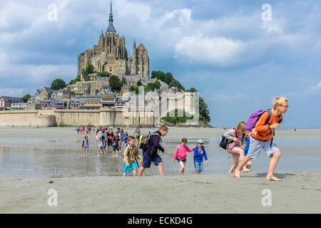 France, Manche, Mont Saint Michel bay, listed as World Heritage by UNESCO, hiking through the bay to Mont Saint - Stock Photo