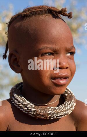 Namibia, Kunene region, Kaokoland, Himba village near Opuwo, Himba girl - Stock Photo
