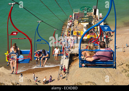 Horizontal aerial view of people on the chairlift at Alum Bay in the Isle of Wight. - Stock Photo