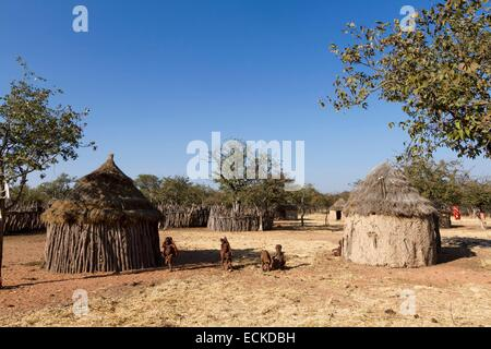 Namibia, Kunene region, Kaokoland, Himba village near Kamanjab, Himba children in front of a hut - Stock Photo