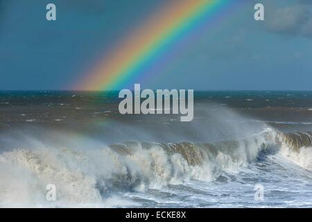 France, Reunion Island (French overseas department), seascape view of a rainbow sky and high waves after the passage - Stock Photo