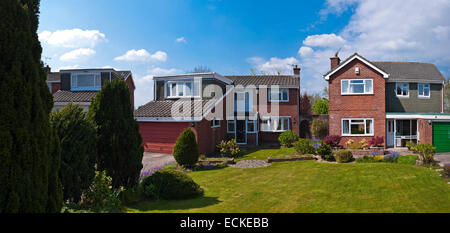 Horizontal exterior of a typical 1980's detached house in the sunshine. - Stock Photo