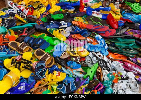 Burkina Faso, Bobo Dioulasso, Toussiana, selling used shoes on a traditional African market - Stock Photo