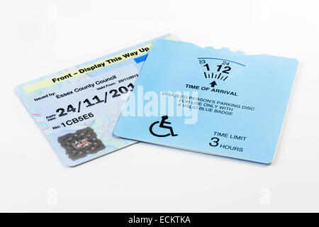 A Disabled Blue Badge pass as issued in the United Kingdom to allow holders special car parking privileges - Stock Photo