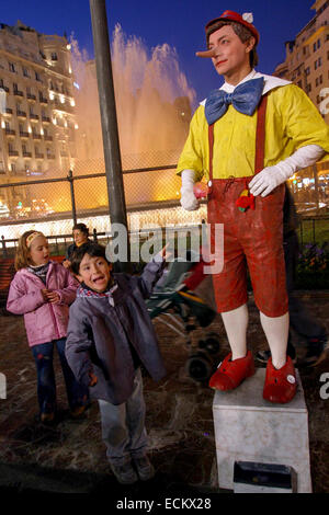 During Las Fallas, a traditional festival in Valencia Spain Street performer Pinocchio - Stock Photo