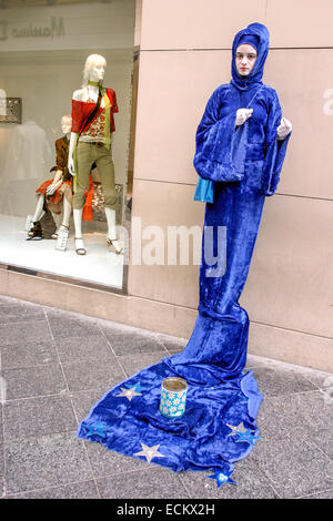 During Las Fallas, a traditional festival in Valencia Spain Street performer - Stock Photo