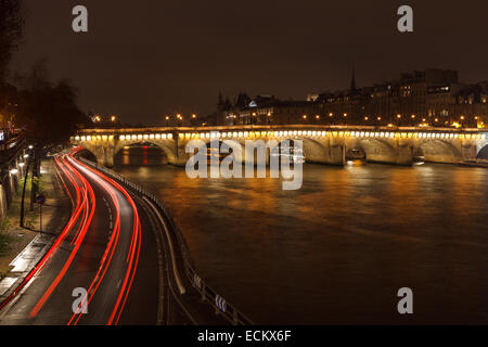 A long exposure shot of Pont Neuf and the Seine River in Paris, France. - Stock Photo