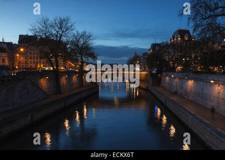 View of Paris and the Seine River at dusk from 'Pont au Double', near Notre Dame Cathedral. Paris, Ile de France, - Stock Photo