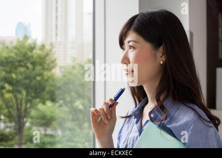 A working woman in an office building. - Stock Photo