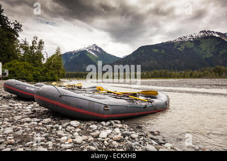 Tsirku river in the Haines Eagle Preserve, near Skagway, Alaska, USA, North America. Rafting boats ready to take - Stock Photo