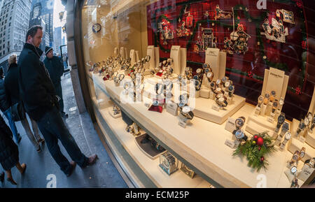 A display of luxury watches is seen in the window of a store in New York on Sunday, December 14, 2014. A recent - Stock Photo