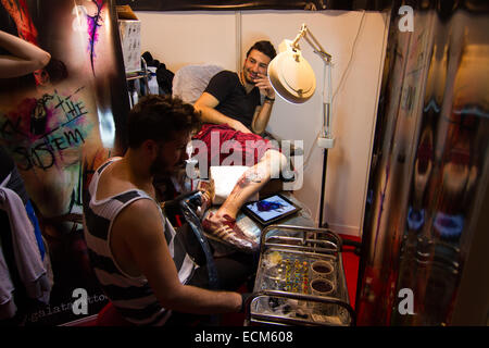 ISTANBUL TURKEY SEPTEMBER 20 2014 Tattoo artist works Istanbul Tattoo Convention which held Kadikoy. - Stock Photo