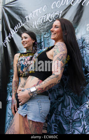 ISTANBUL TURKEY SEPTEMBER 20 2014 Tattooists girls Istanbul Tattoo Convention which held Kadikoy. - Stock Photo