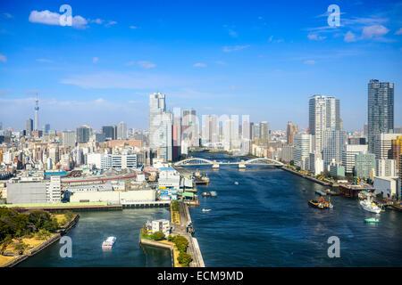 Tokyo, Japan city skyline over the Sumida River. - Stock Photo