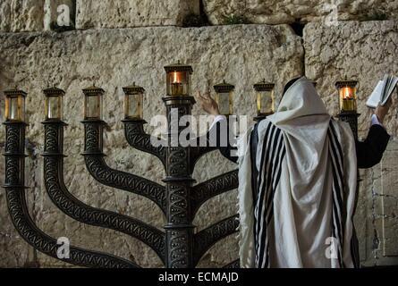 (141217) -- JERUSALEM, Dec. 17, 2014 (Xinhua) -- An Ultra-Orthodox Jewish man prays to mark Hanukkah in front of - Stock Photo
