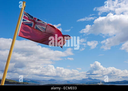Red Ensign flag of the British merchant marine at Ferry to Mull island from Oban, West Highlands, Argyll and Bute, - Stock Photo
