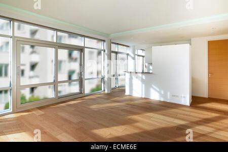Empty room, living room, white walls, hardwood floor - Stock Photo