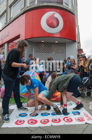 UKUncut activists protesting outside the Vodafone shop on London's Oxford Street. The protesters played 'Tax-Dodge - Stock Photo