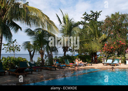 Swimming pool of Bali Dream House Hotel Amed. Bali. 'BALI DREAM HOUSE' hotel is located on the North-East cost of - Stock Photo