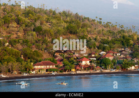 The small village of Amed fisherman with views of Mount Gunung Agung background (3142m). East Bali. Amed is a long - Stock Photo