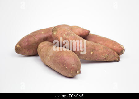 Four Sweet Potatoes on a White Background. - Stock Photo