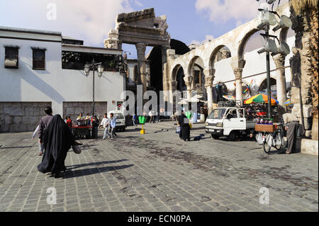 View of Al-Hamidiyah Souq entrance from back of Umayyad Mosque and Rome ruins in Damascus. Bazaar is the largest - Stock Photo