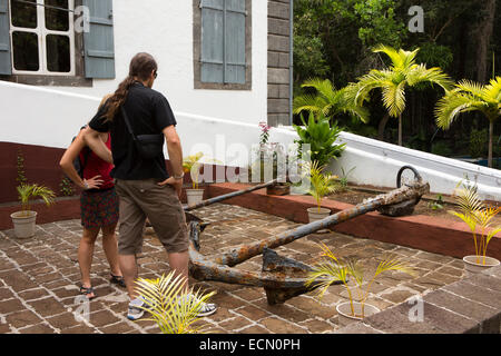 Mauritius, Mahebourg, National History Museum, tourists looking at old rusty naval anchors - Stock Photo