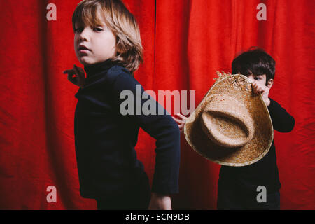 Studio portrait of two boys wearing black clothes - Stock Photo