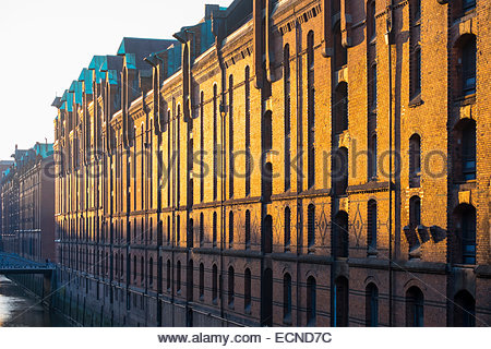 Old warehouses along Brooksfleet canal in the Speicherstadt warehouse district, HafenCity, Hamburg, Germany - Stock Photo