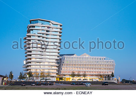 Marco-Polo-Tower and Unilever builidng (Unilever-Haus) on Strandkai at dusk, HafenCity, Hamburg, Germany - Stock Photo