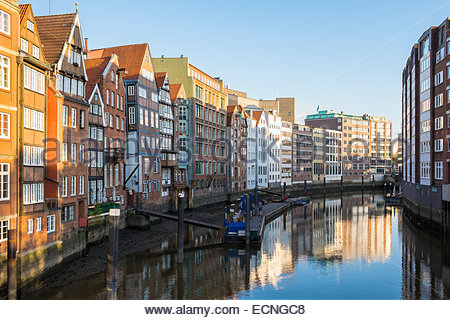 Old houses along the Nikolaifleet canal in early morning, Altstadt, Hamburg, Germany - Stock Photo
