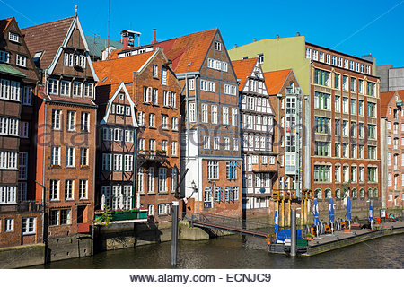 Old houses along the Nikolaifleet canal on a sunny afternoon, Altstadt, Hamburg, Germany - Stock Photo