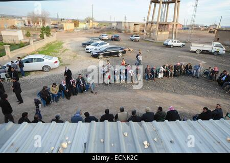 Suruc, Turkey. 17th Dec, 2014. The family of Mr. Hermi are over come with grief by his death. The family and Kurdish - Stock Photo