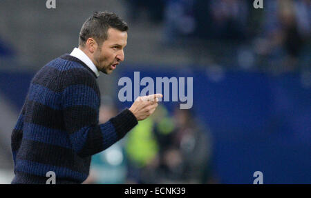 Hamburg, Germany. 16th Dec, 2014. Hamburg's trainer Josef Zinnbauer gestures during the German Bundesliga soccer - Stock Photo
